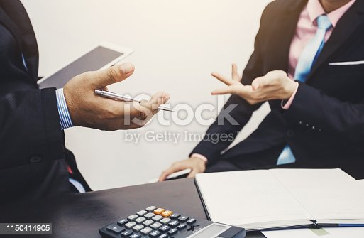istock Teamwork process, business people working in the office discussing documents and ideas at meeting 1150414905