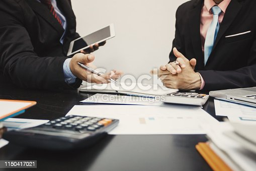 istock Teamwork process, business people working in the office discussing documents and ideas at meeting 1150417021