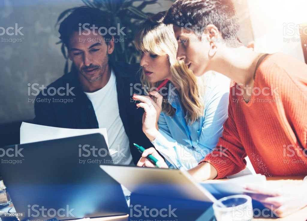 Teamwork process concept.Young coworkers team work with new startup project in office.Business people working at meeting room.Horizontal, blurred background. Teamwork process concept.Young coworkers team work with new startup project in office.Business people working at meeting room.Horizontal, blurred background Global Stock Photo