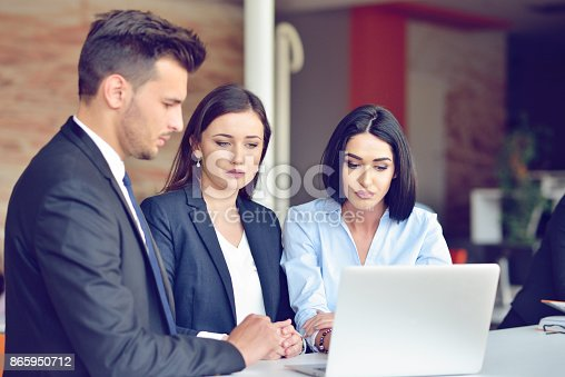 istock Teamwork process concept.Young coworkers work with new startup project in office.Analyze document, plans. 865950712