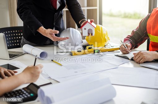 1174841541 istock photo Teamwork process, Engineer and businessman meeting and planning construction project together. 1159058767