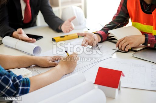 1174841541 istock photo Teamwork process, Engineer and businessman meeting and planning construction project together. 1159058775