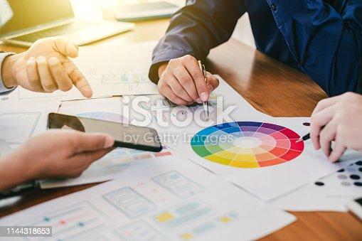826047464 istock photo Teamwork process, Graphic designer creative planning work together on website ux ui app development. 1144318653