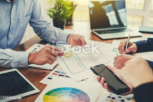istock Teamwork process, Graphic designer creative planning work together on website ux ui app development. 1144318799