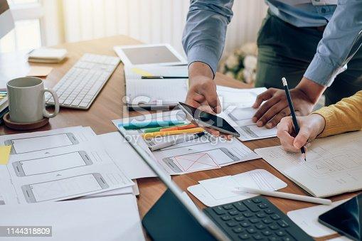 istock Teamwork process, Graphic designer creative planning work together on website ux ui app development. 1144318809