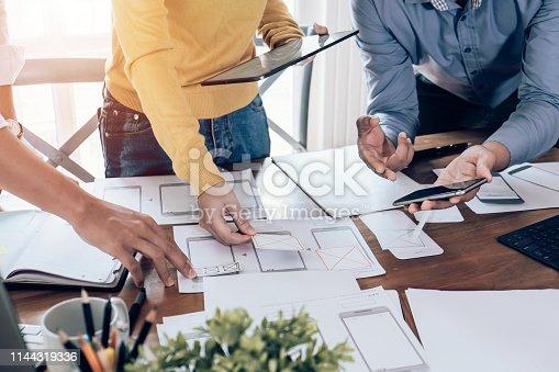 826047464 istock photo Teamwork process, Graphic designer creative planning work together on website ux ui app development. 1144319336