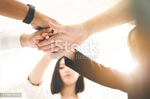 1016771914 istock photo Teamwork together of business people. Combining power and encouragement 1173712122