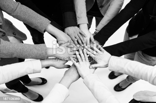 Business person Stacking hands.Unity or cooperation concept.