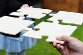 istock Teamwork with a large jigsaw puzzle 175486367