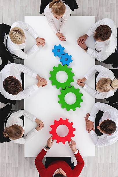 Teamwork with cogs of business stock photo