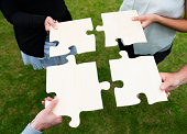 istock Teamwork with large group of people and a jigsaw puzzle 175504053
