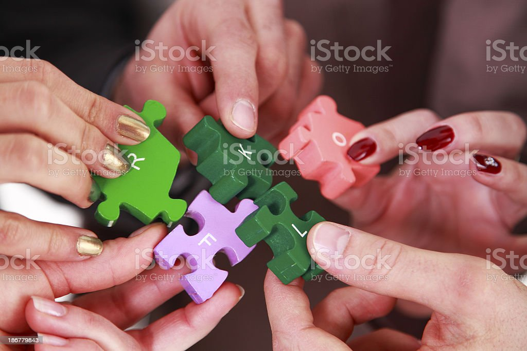 Teamwork with puzzle royalty-free stock photo
