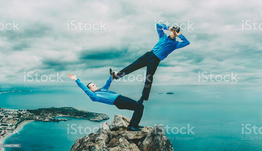 Teamwork with two businessmen facing difficulties stock photo