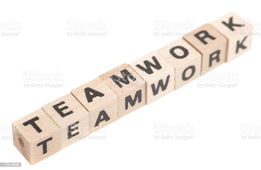 teamwork word with wodden toy cubes on white background royalty-free stock photo