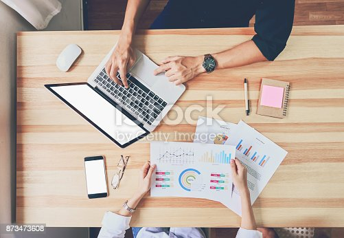 istock teamwork, Young businesswoman in office in casual shirt. Selecting information with colleagues with a computer. Business Marketing Planning 873473608