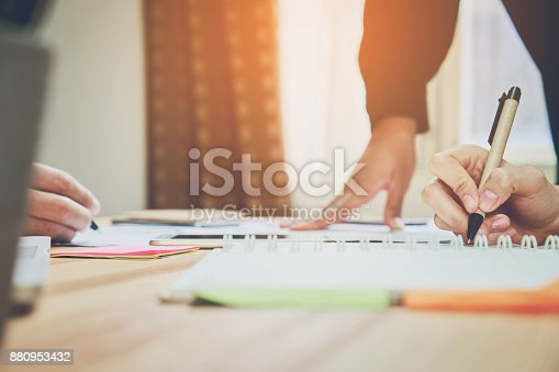 istock teamwork, Young businesswoman in office in casual shirt. Selecting information with colleagues with a computer. Business Marketing Planning. 880953432