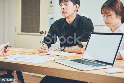 825180614 istock photo teamwork, Young businesswoman in office in casual shirt. Selecting information with colleagues with a computer. Business Marketing Planning. 927626526