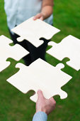 istock Teamworking with a jigsaw puzzle 175504339