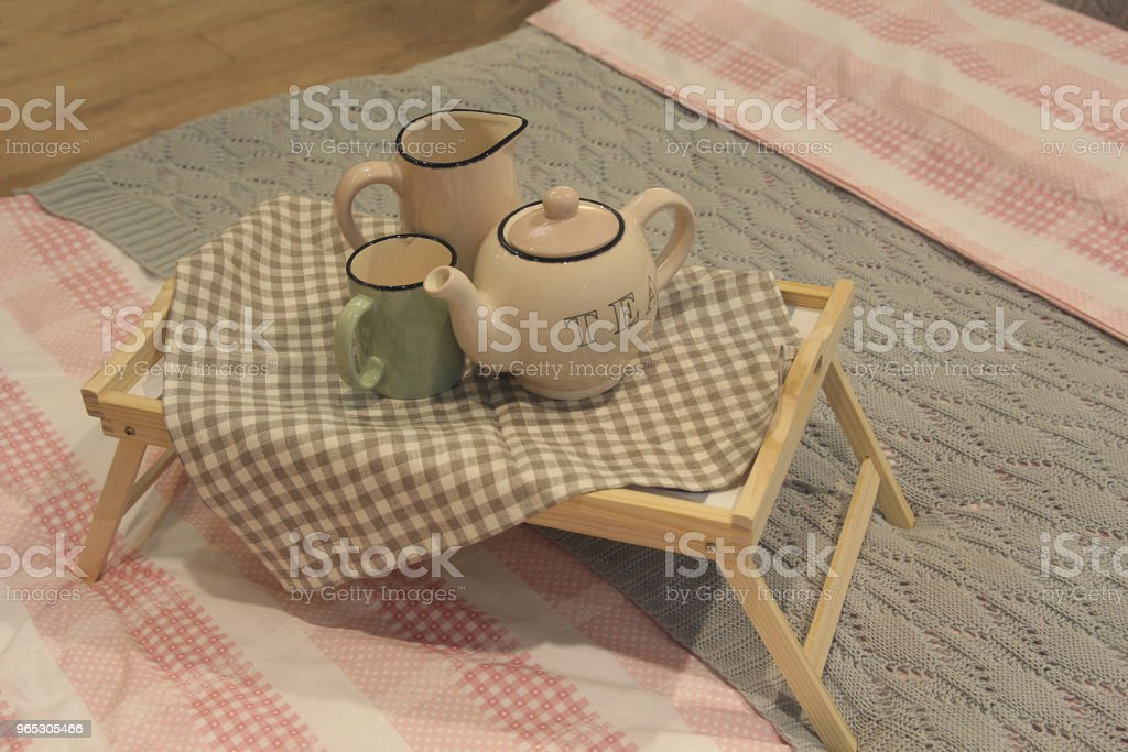 Teapot and coffee pot and interior decor on the bed with linen royalty-free stock photo