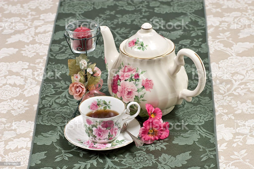 Teapot and cup of tea on a table royalty-free stock photo