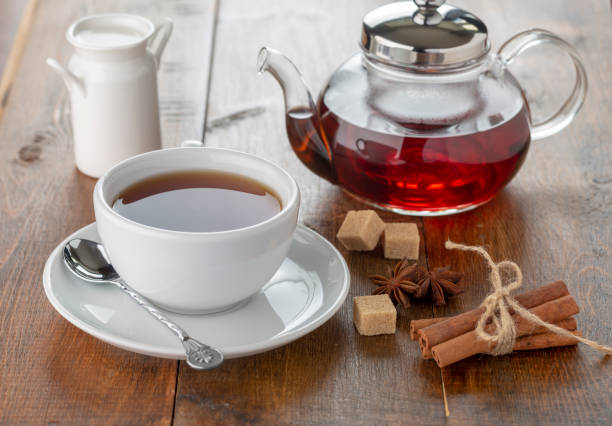teapot and cup on a wooden tray. top view stock photo