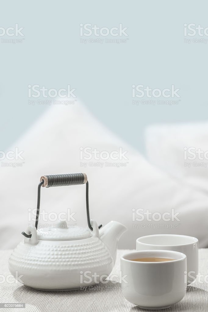 Teapot and cups on table at comfortable relaxation lounge stock photo