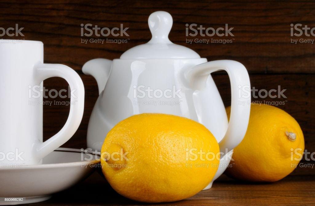 Teapot and Mug with Lemons stock photo