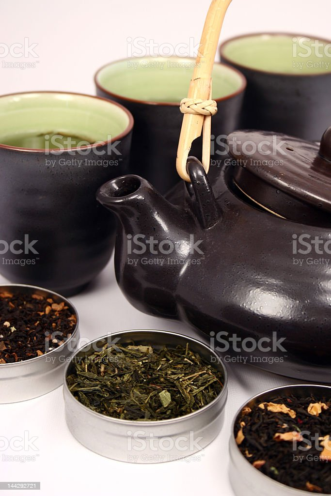teapot, cups and a selection of green teas royalty-free stock photo