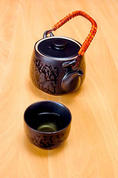 Teapot + green tea stock photo