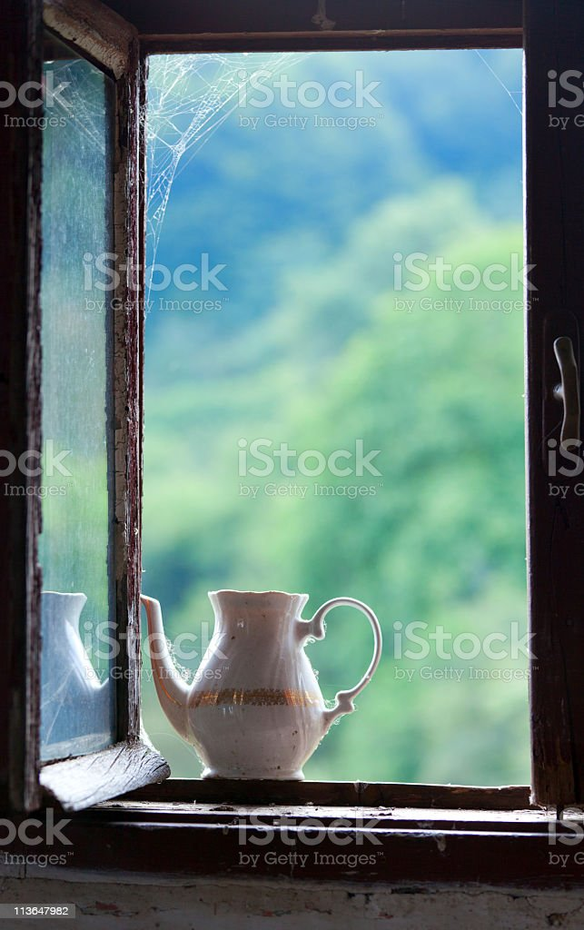 Teapot in the window royalty-free stock photo