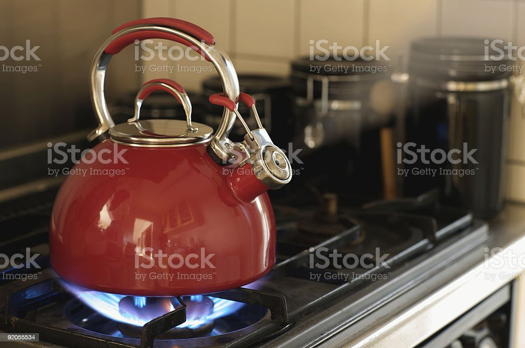 Teapot on a Stove stock photo