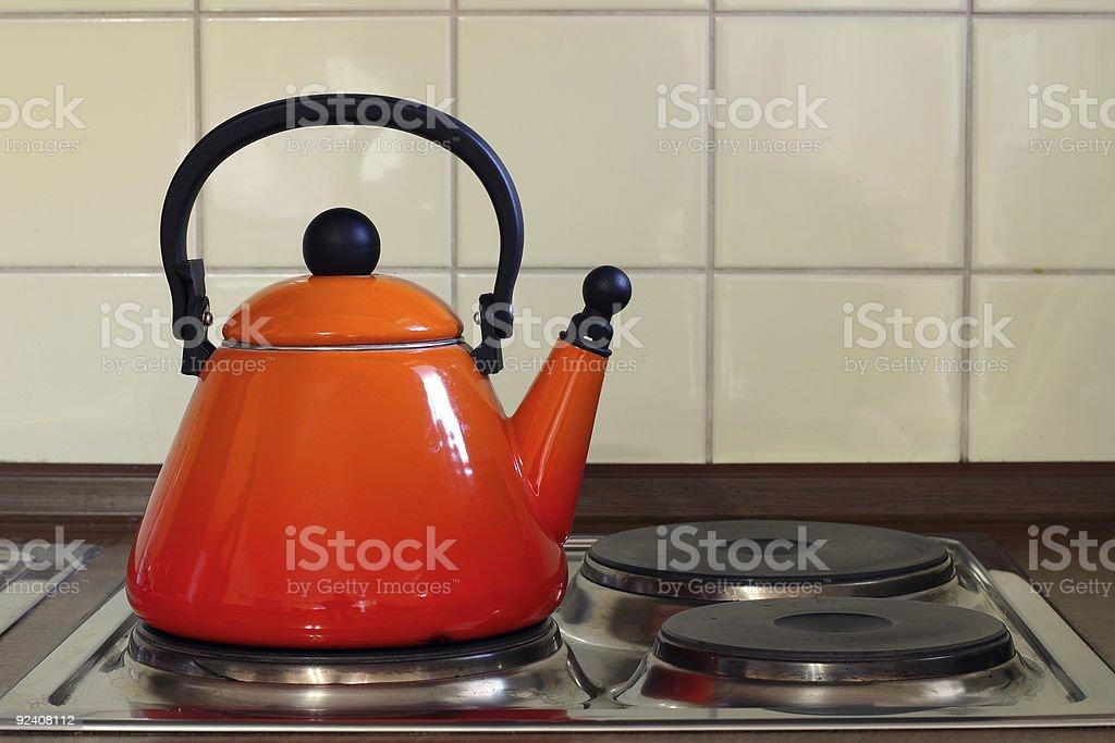 Teapot on Kitchen Oven stock photo