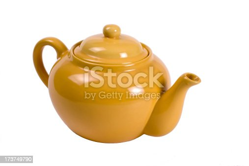 A mustard colored teapot.