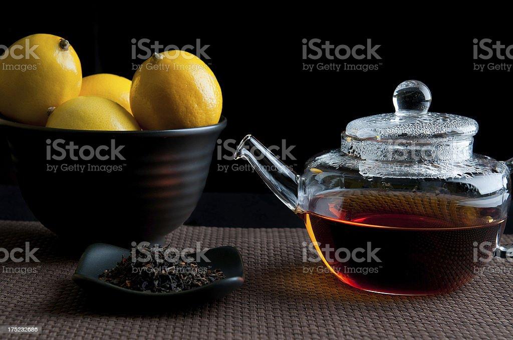 Teapot, Tea Leaves and Lemons royalty-free stock photo