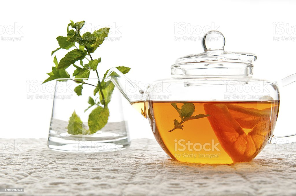 Teapot with Lemon, Tea and Mint royalty-free stock photo