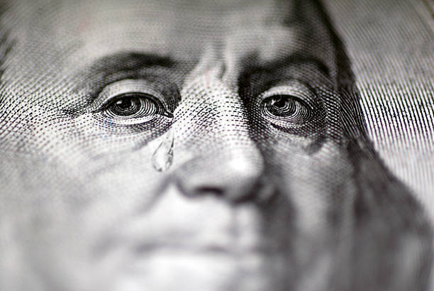 tear falling from face on us dollar bill, close-up - hoarding stock photos and pictures