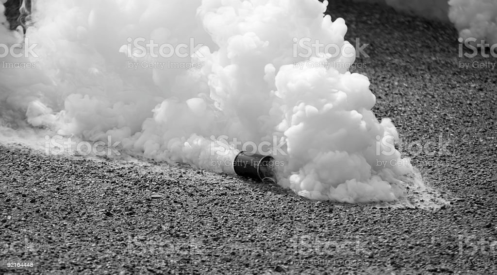 Tear gas in motion in black and white  stock photo