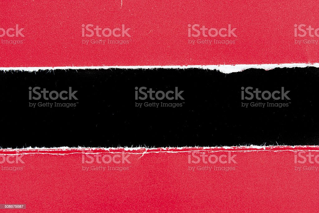 tear red paper pieces of paper on black royalty-free stock photo