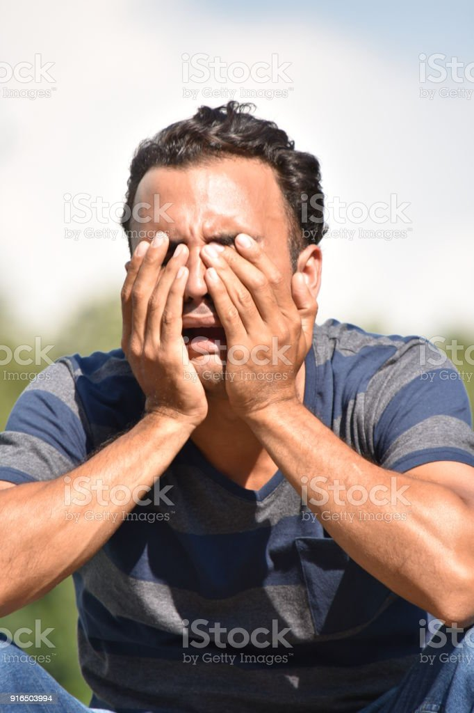 Tearful Minority Male stock photo