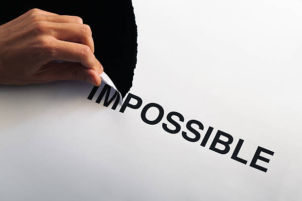 tearing impossible - possible stock photos and pictures