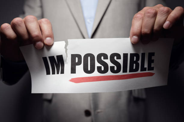 tearing the word impossible to make possible motivation - possible stock photos and pictures