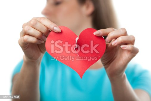 istock Tearing up a paper heart, breakup concept 182747598