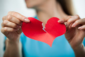 istock Tearing up a paper heart, breakup concept 182781451