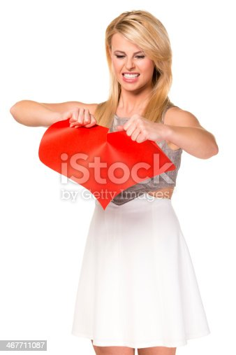istock Tearing up a paper heart, breakup concept 467711087