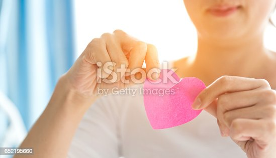 istock tearing up heart shape paper 652195660
