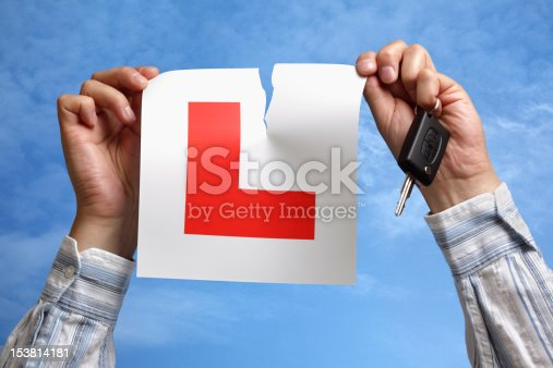 istock Tearing up L plate after passing driving test 153814181