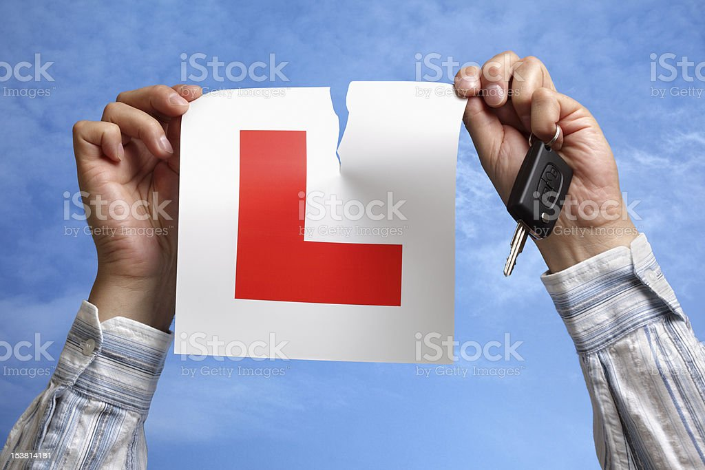 Tearing up L plate after passing driving test stock photo
