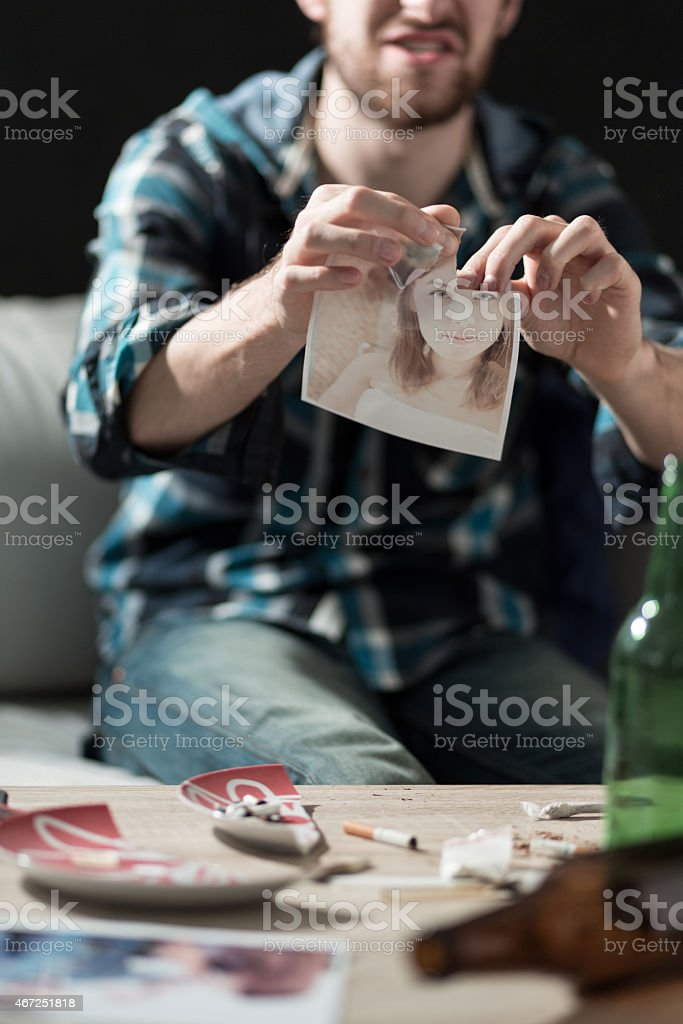 Tearing up the photo stock photo