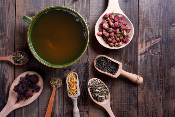 teas from around the world - tea leaf stock photos and pictures