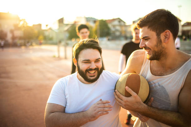 Teasing best friend after losing a game stock photo